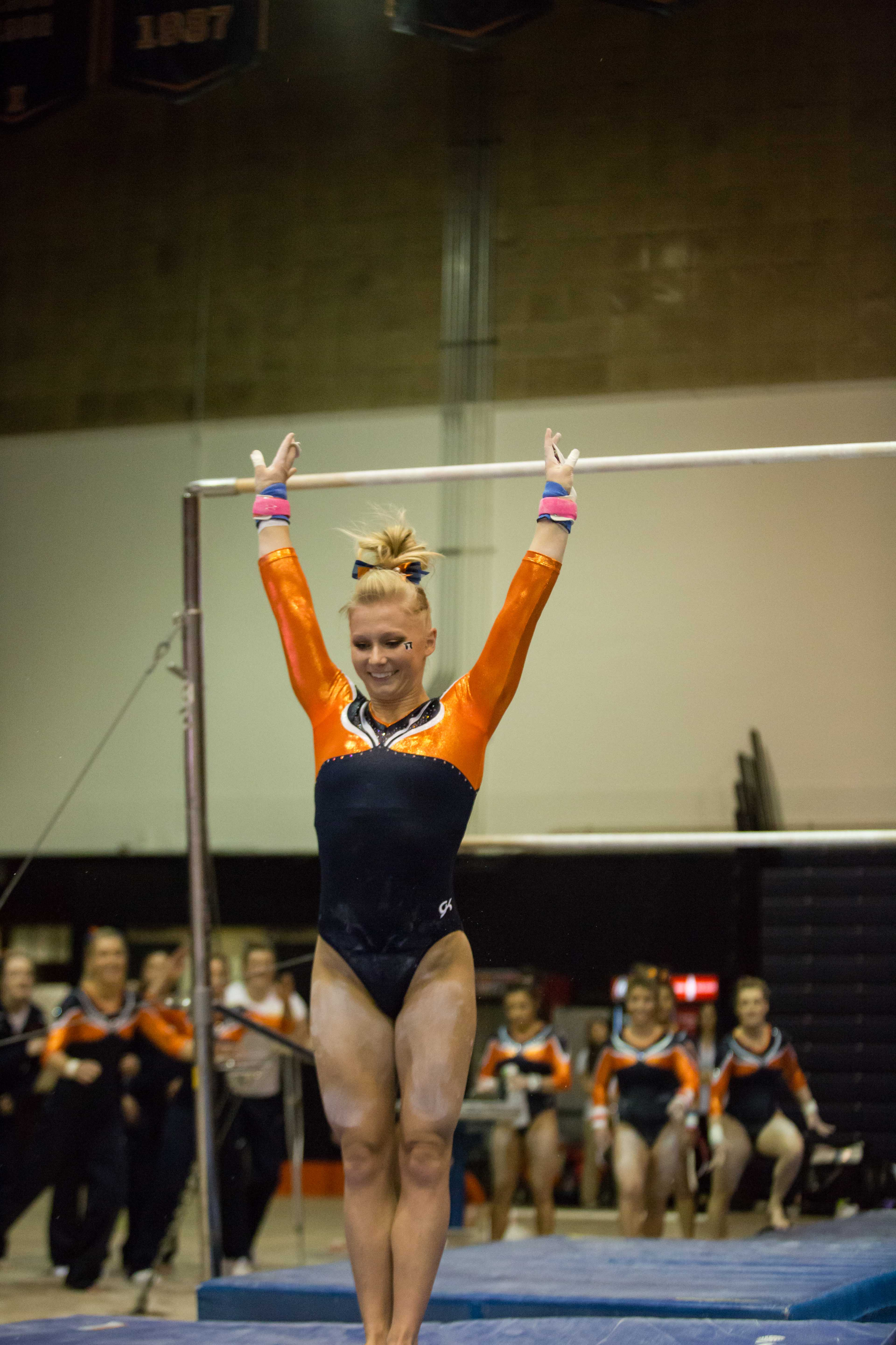 Illinois' Erin Buchanan lands successfully after performing a routine on the uneven parallel bars during the State of Illinois Classic at Huff Hall on Saturday, March 5, 2015. The Illini claimed victory for the ninth consecutive year with a total of 195.425 over Northern Illinois (194.225), UIC(192.625) and Illinois State (191.500).