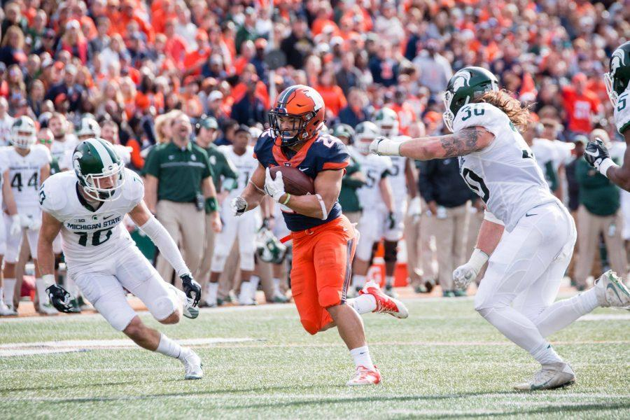 Illinois+running+back+Kendrick+Foster+runs+for+a+touchdown+against+Michigan+State+on+Nov.+5.+Foster%2C+along+with+other+seniors%2C+is+excited+about+leadership+opportunities.++