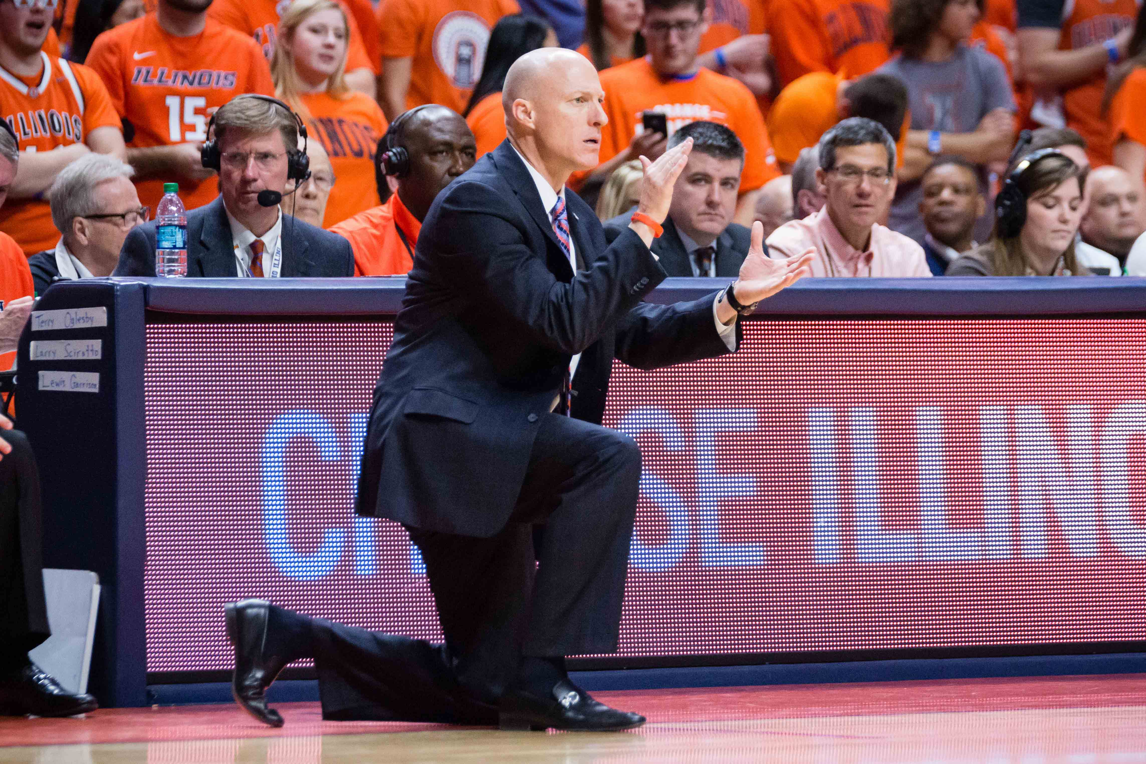 Illinois head coach John Groce claps for his team during the game against Penn State at State Farm Center on Saturday, February 11. The Illini lost 83-70.