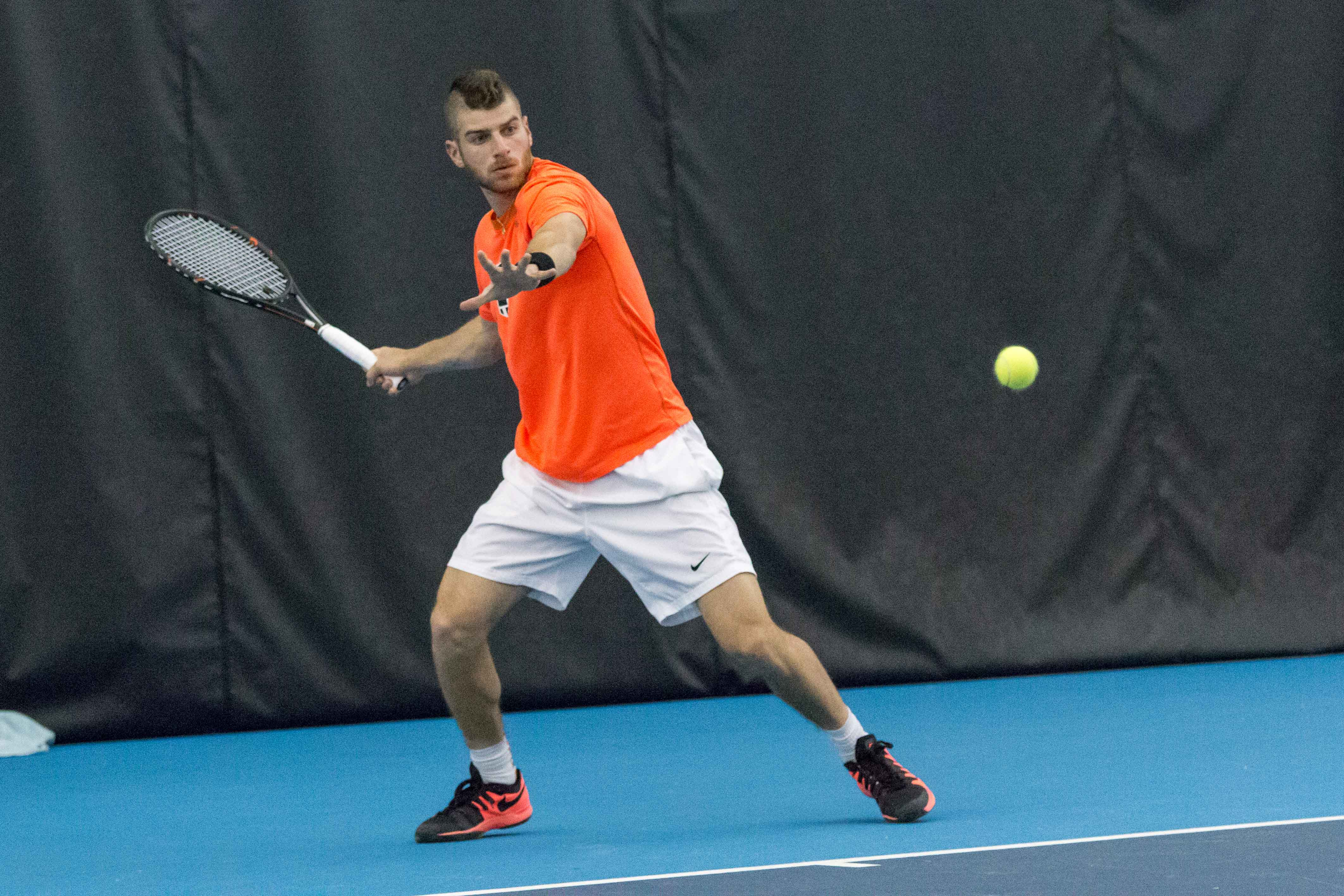Illinois' Aron Hiltzik gets ready to return the ball during the match against Wisconsin at the Atkin's Tennis Center on Sunday, April 3. The Illini won 4-0.