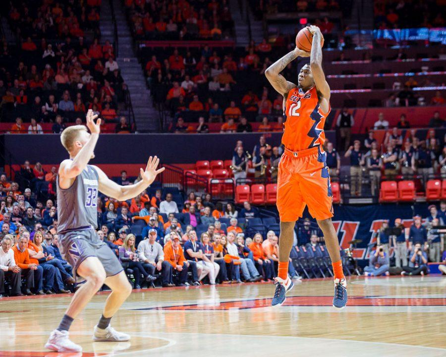 Illinois' Leron Black (12) shoots a three during the game against Northwestern at State Farm Center on Tuesday, February 21.