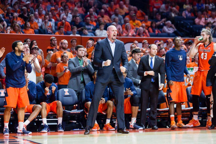 Illinois' strength and conditioning coach Adam Fletcher celebrates during the game against Northwestern at State Farm Center on Tuesday, February 21.