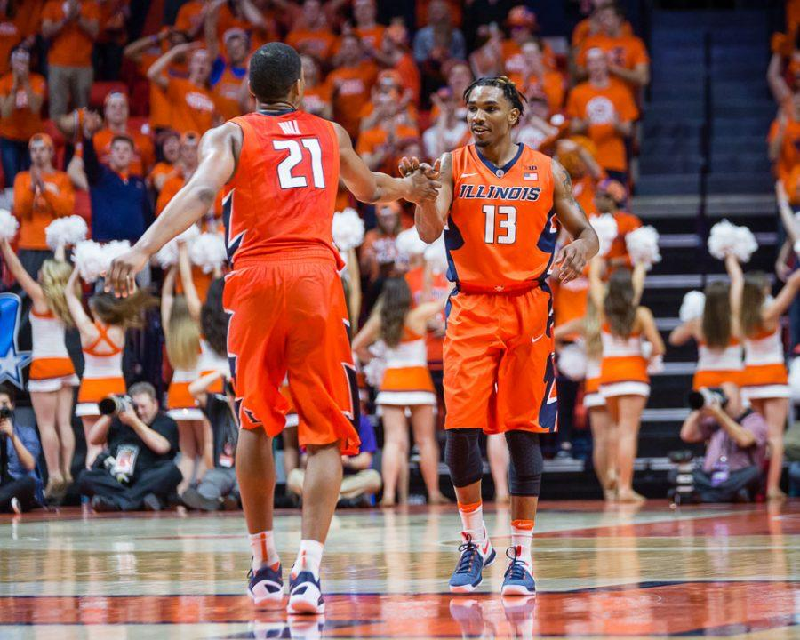 Illinois' Malcolm Hill (21) high fives Tracy Abrams (13) after Abrams hit a three during the game against Northwestern at State Farm Center on Tuesday, February 21.