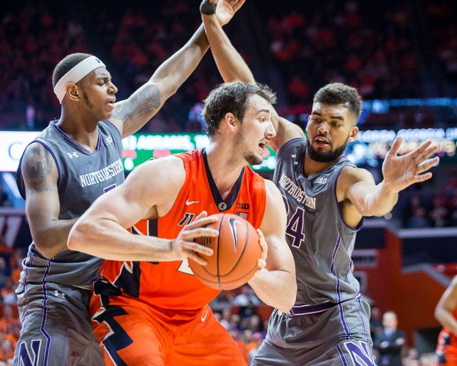 Illinois' Maverick Morgan (22) gets doubled teamed during the game against Northwestern at State Farm Center on Tuesday, February 21.