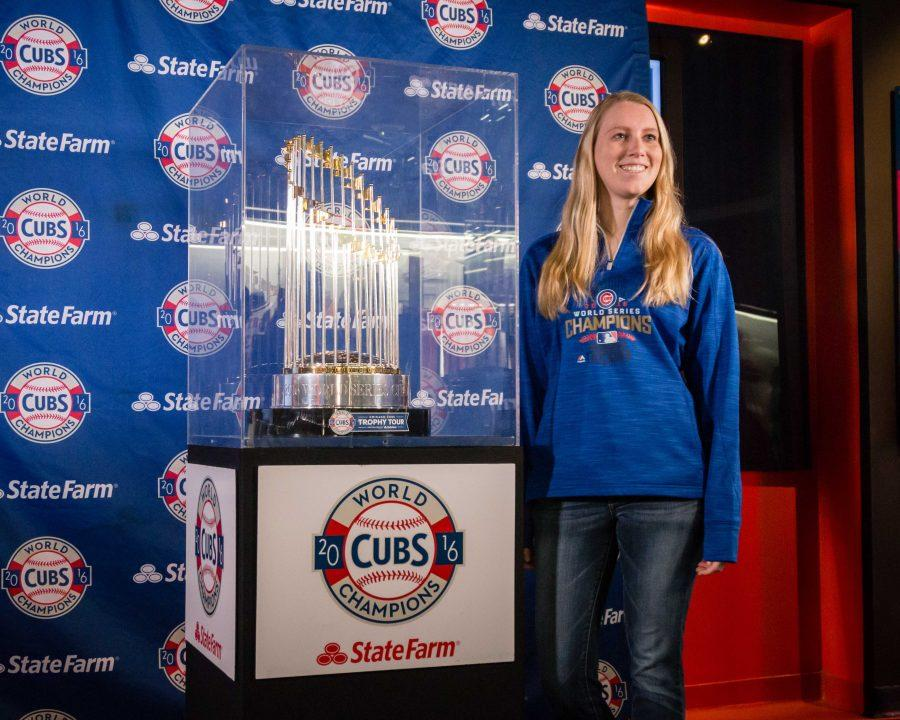 A fan gets a picture with the World Series Trophy at the Hall of Fame in State Farm Center on Saturday.