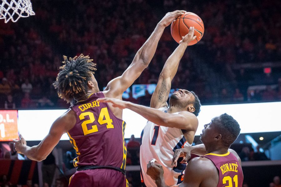 Illinois' Jaylon Tate (1) gets blocked by Minnesota's Eric Curry (24) during the game against Minnesota at State Farm Center on Saturday, February 4. The Illini lost 68-59.