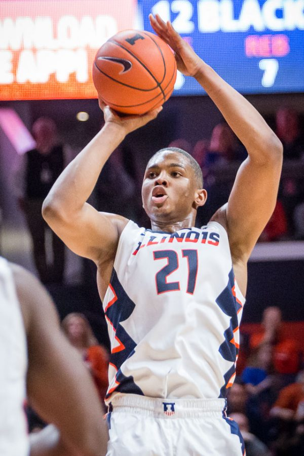 Illinois' Malcolm Hill (21) takes a jump shot during the game against Minnesota at State Farm Center on Saturday, February 4. The Illini lost 68-59.