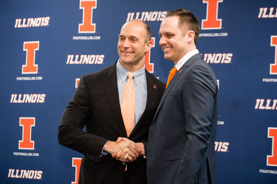 Illinois+athletic+director+Josh+Whitman+shakes+hands+with+new+volleyball+head+coach+Chris+Tamas+during+the+press+conference+at+the+Division+of+Intercollegiate+Athletics+on+Friday%2C+February+10.