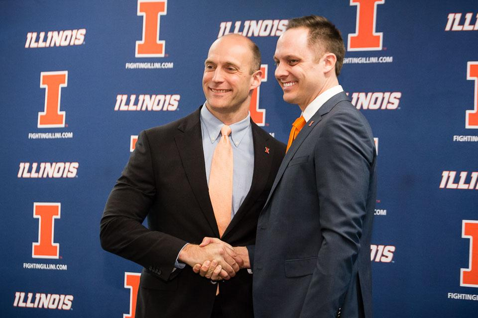 Illinois athletic director Josh Whitman shakes hands with new volleyball head coach Chris Tamas during the press conference at the Division of Intercollegiate Athletics on Friday, February 10.