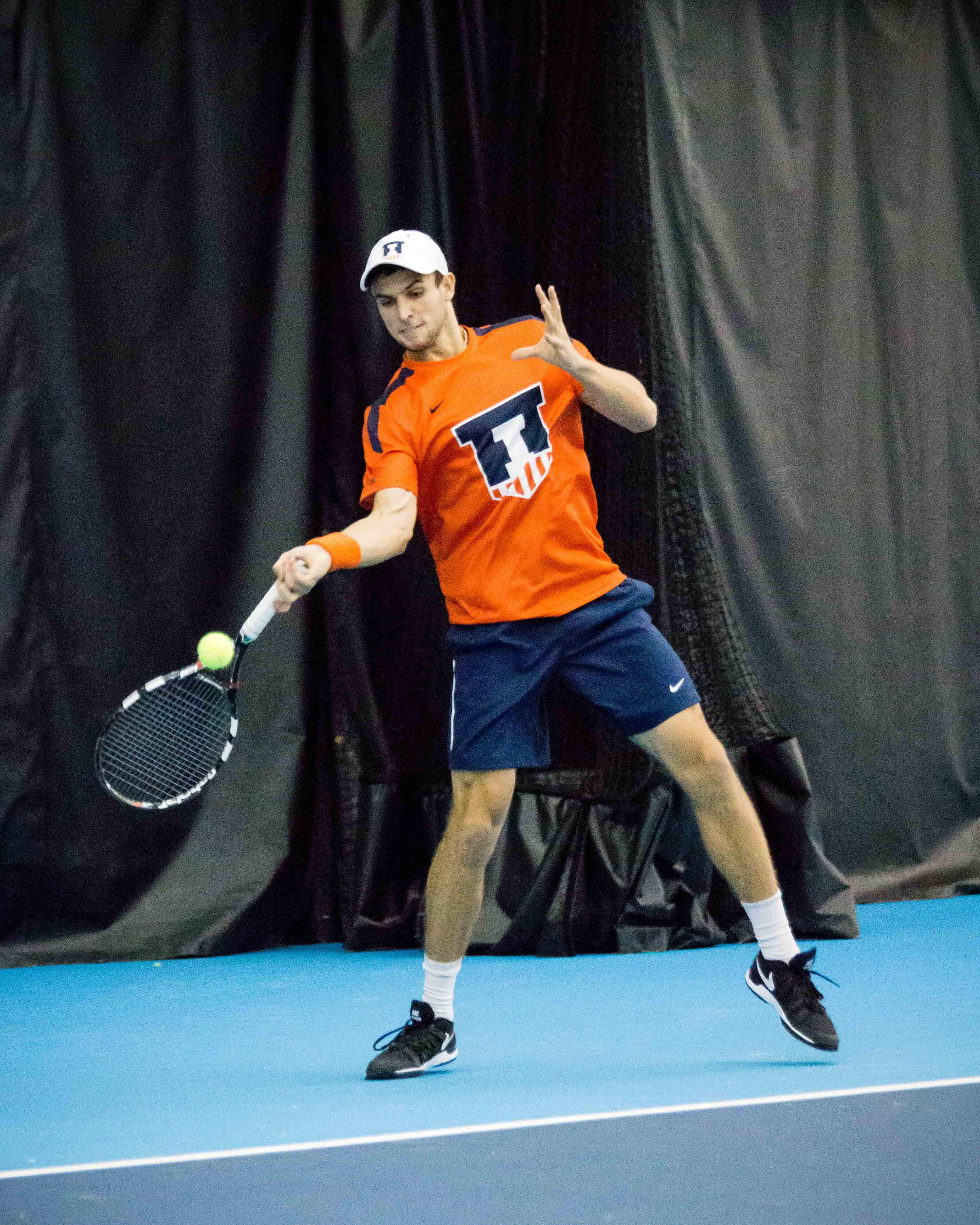 Illinois' Aleks Vukic returns the ball during the match against Indiana at Atkins Tennis Center on Friday, February 10.