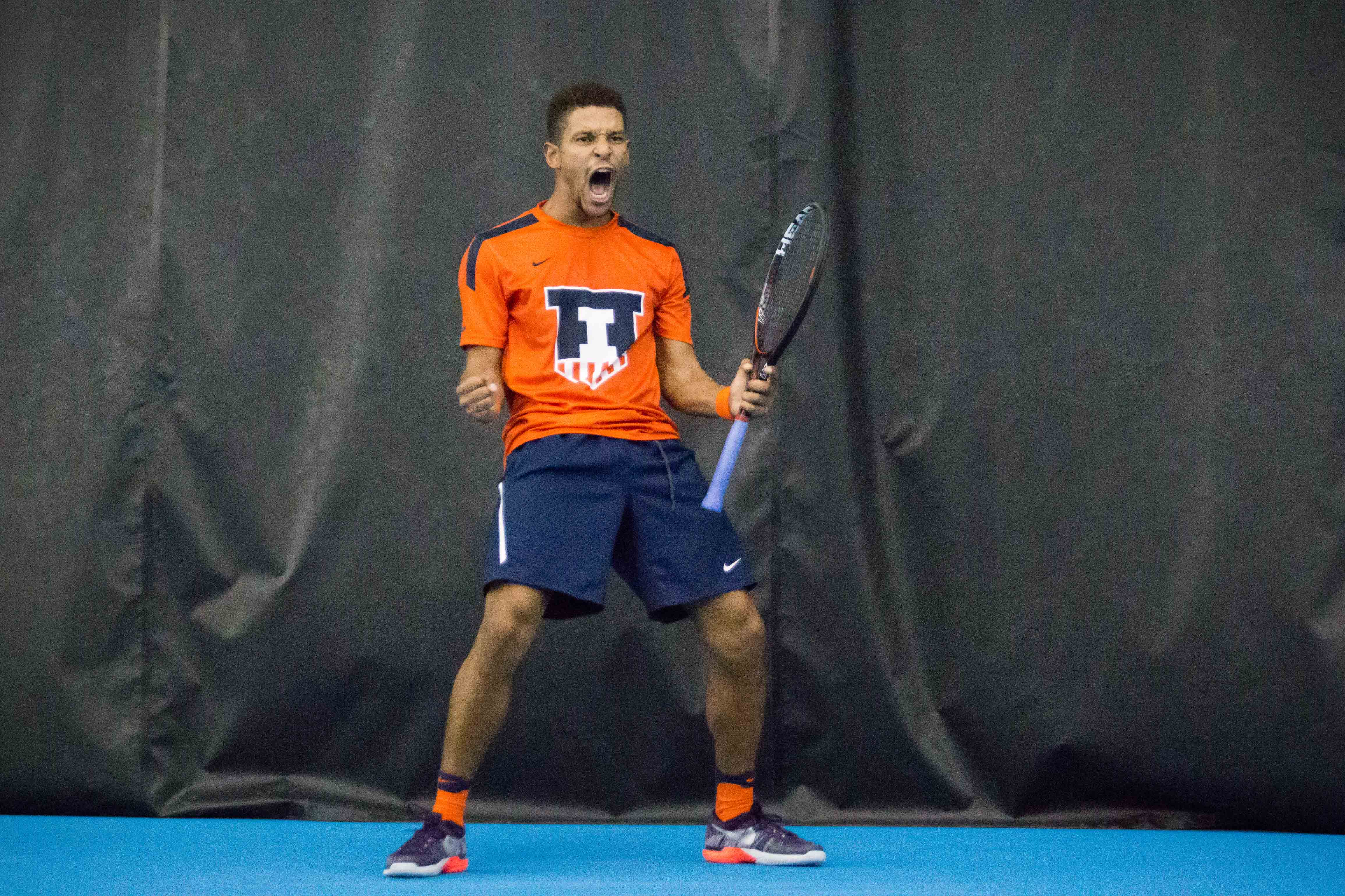 Illinois' Julian Childers celebrates after winning a game in his match against Indiana's Matthew McCoy at Atkins Tennis Center on Friday, February 10. Childers defeated McCoy and the Illini won 5-2.