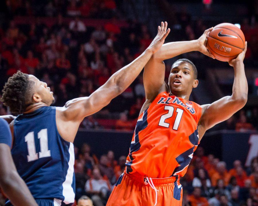 Illinois' Malcolm Hill (21) looks to pass the ball during the game against Penn State at State Farm Center on Saturday, February 11.