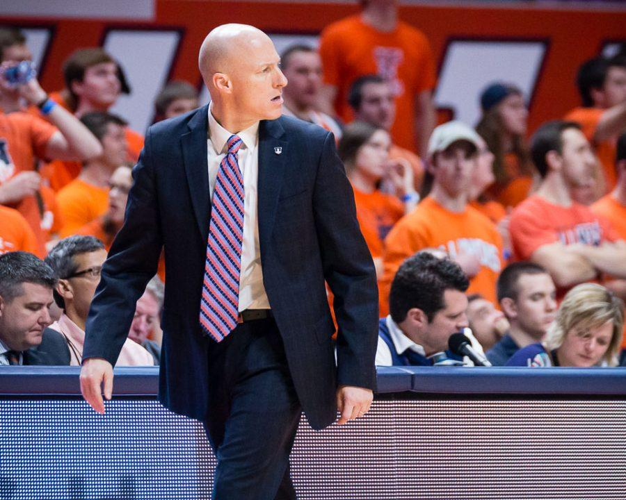 Illinois head coach John Groce walks back to the bench after a foul called on the Illini during the game against Penn State at State Farm Center on Saturday, February 11. The Illini lost 83-70.