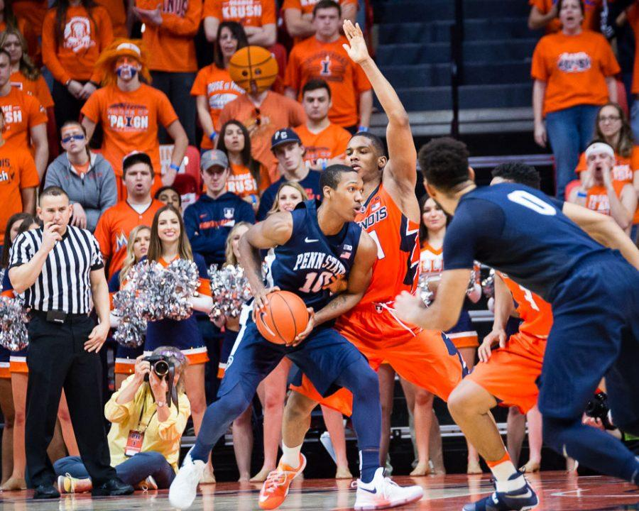 Illinois' Malcolm Hill (21) plays defense during the game against Penn State at State Farm Center on Saturday, February 11. The Illini lost 83-70.