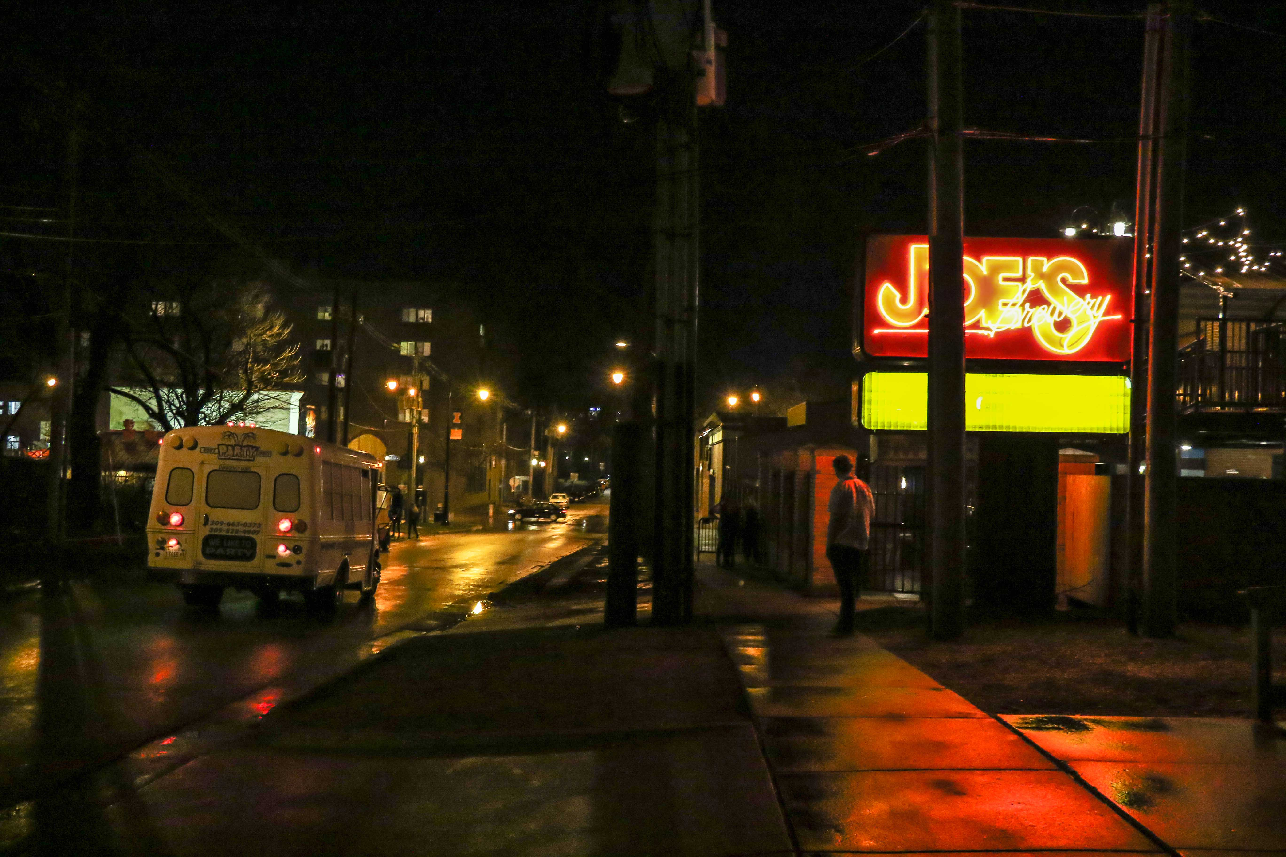 A Bob's Party Express Bus drives away after dropping off students from Illinois State University at Joe's Brewery on Monday night, Feb. 27.