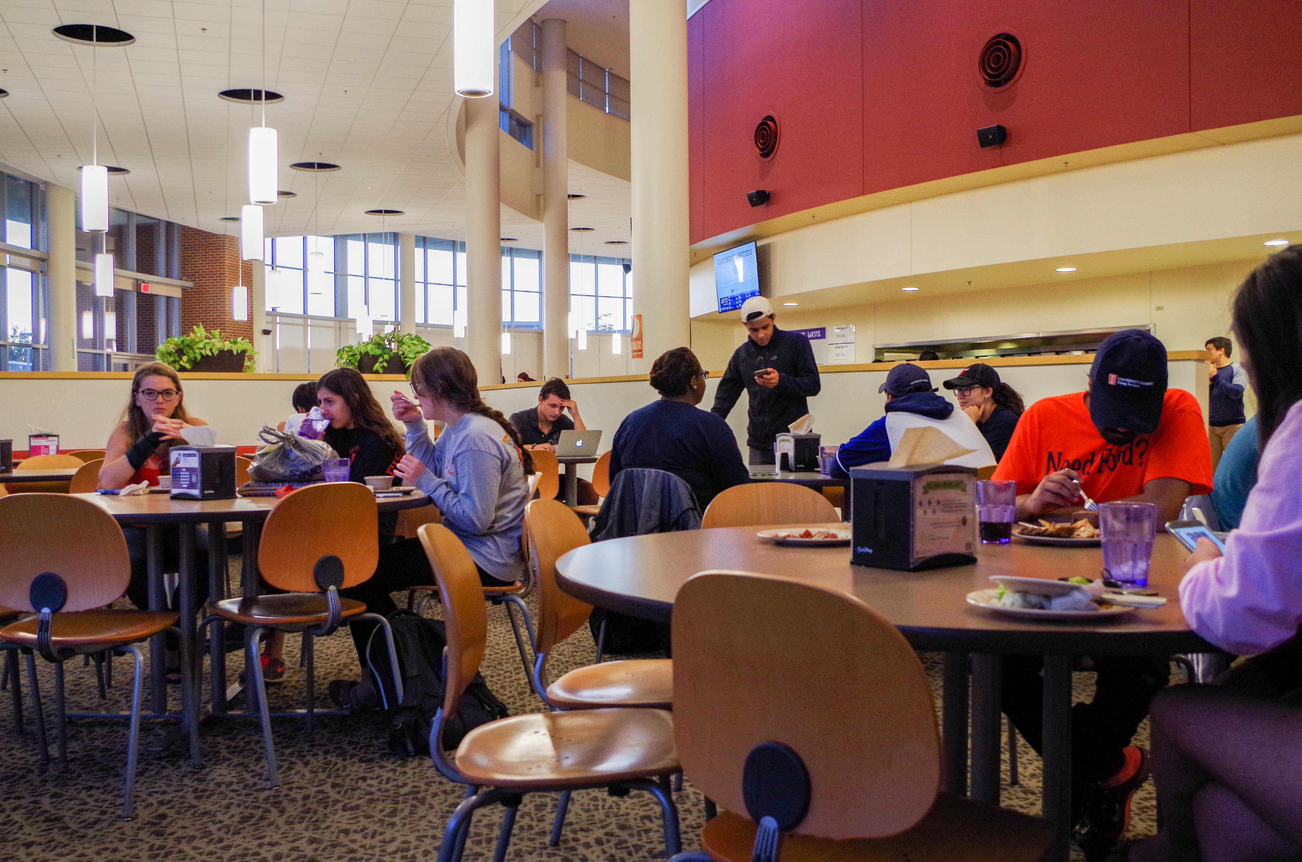 Students eat at the Ikenberry Dinning Hall and enjoy the multiple cuisines it has to offer.