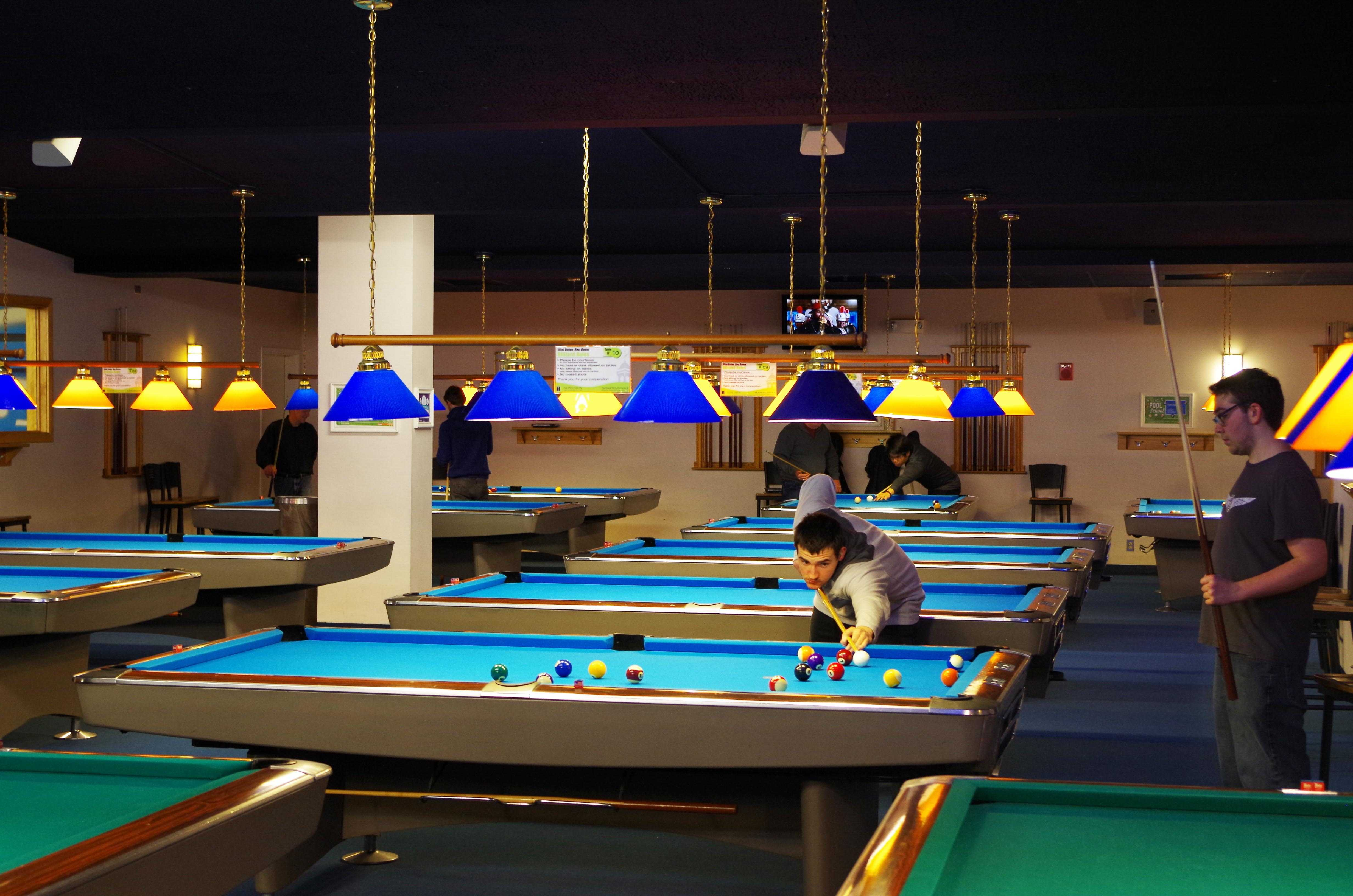 Students receive pool lessons in the Rec Room in the Illini Union every Monday night for 7 weeks for $50.