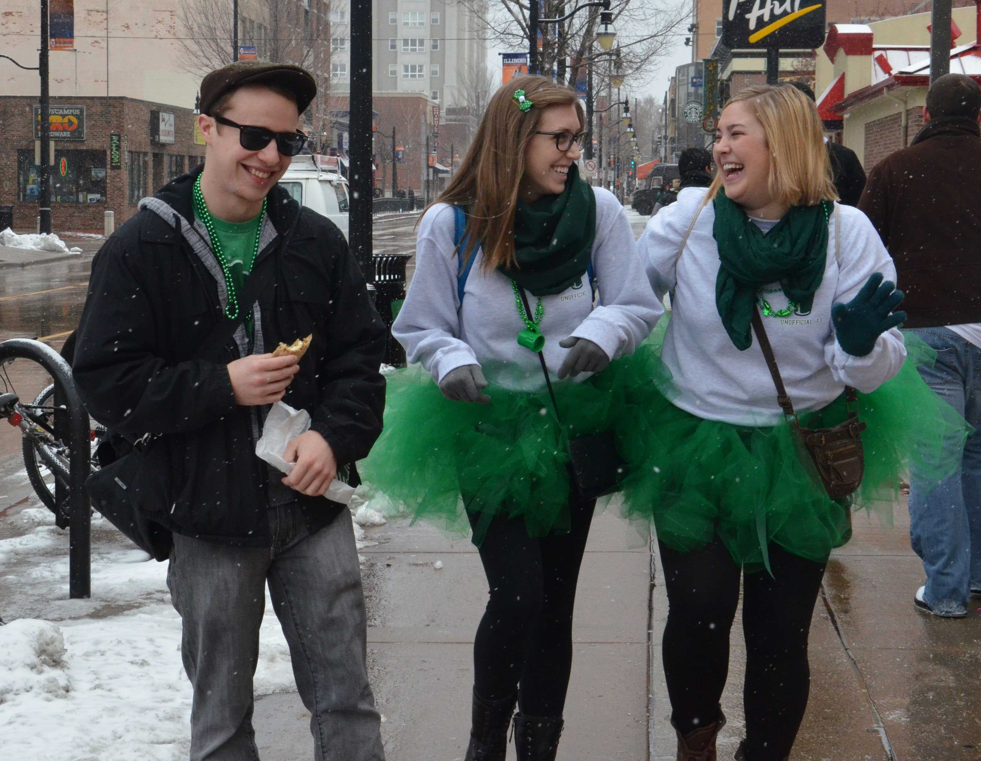 Students walk down Green Street during Unofficial 2013.