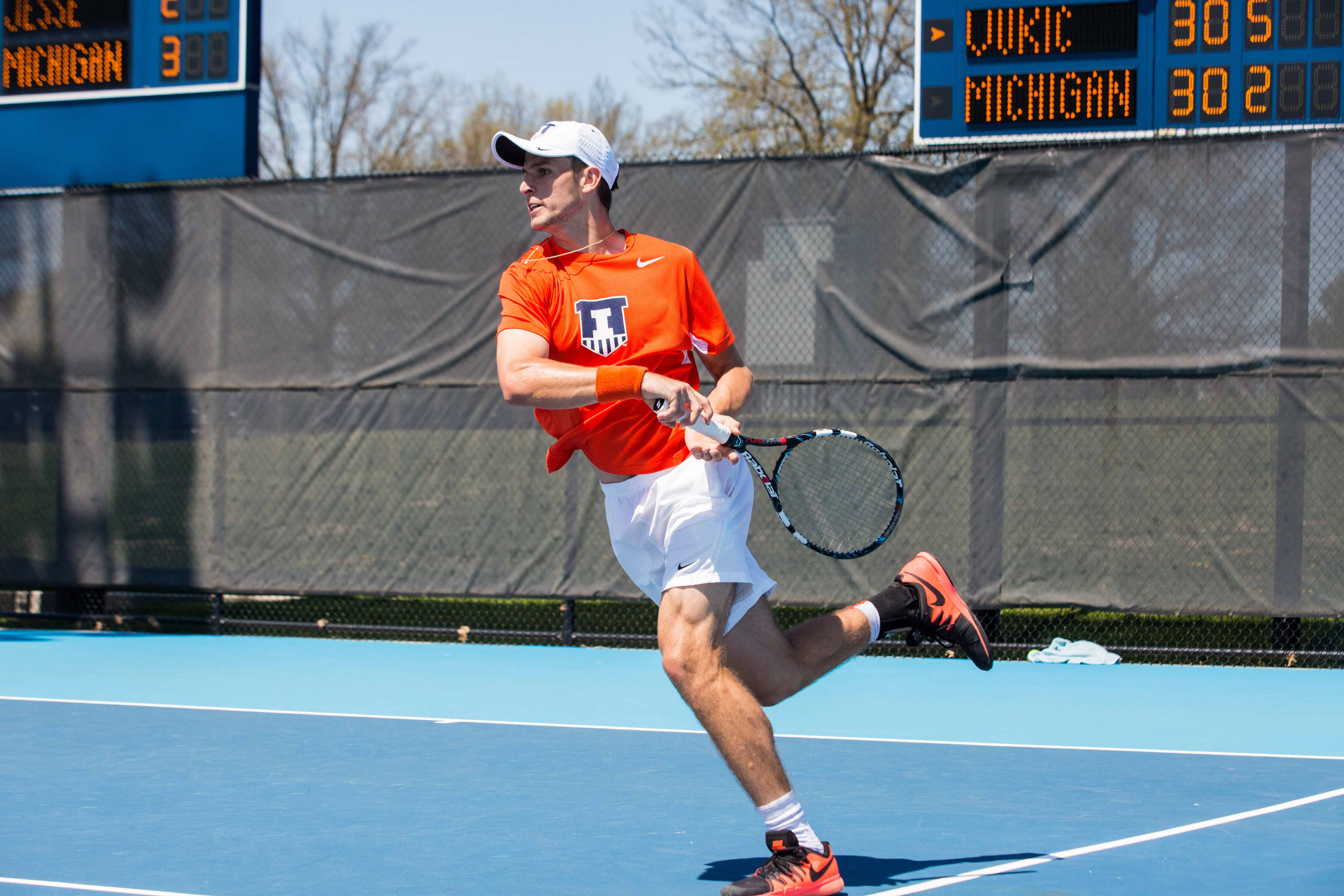 Illinois' Aleks Vukic returns the ball during the meet against No. 21 Michigan at the Atkins Tennis Center on April 17, 2016.