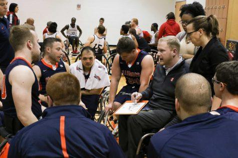 Men's Wheelchair basketball's head coach Matt Buchi talks to his players during a timeout at the ARC on Jan. 28th.