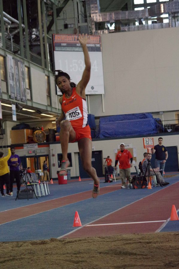 Illinois' Janile Rogers attempts the long jump in the Orange & Blue Meet at the Armory on Saturday Feb. 20, 2016.