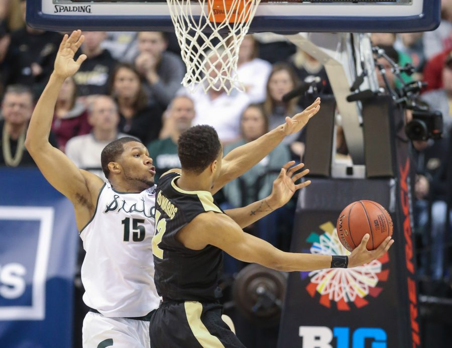 Michigan States Marvin Clark Jr. defends against Purdue's Vince Edwards during the second half on Sunday, March 13, 2016, at Bankers Life Field house in Indianapolis.