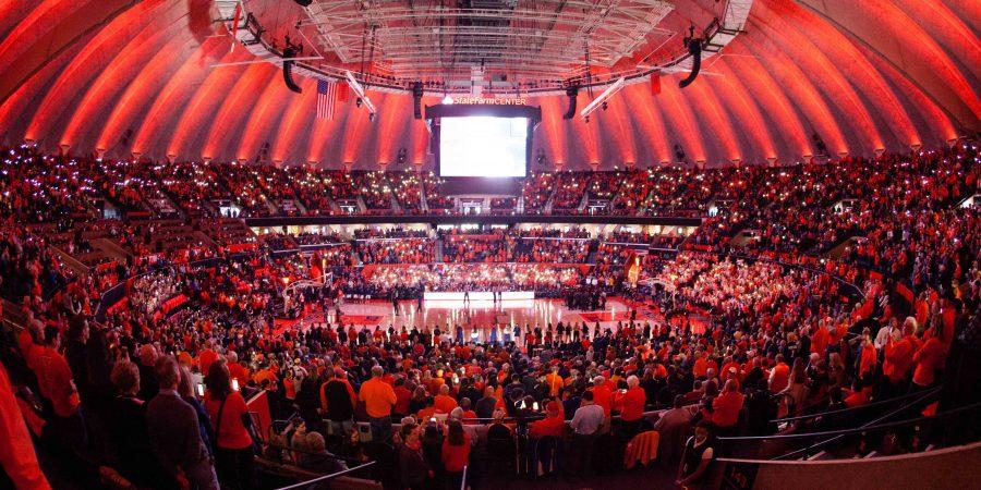 Fans+hold+up+the+flash+lights+on+their+phones+for+a+light+show+before+the+game+against+Minnesota+at+State+Farm+Center+on+Saturday%2C+February+4.+The+Illini+lost+68-59.