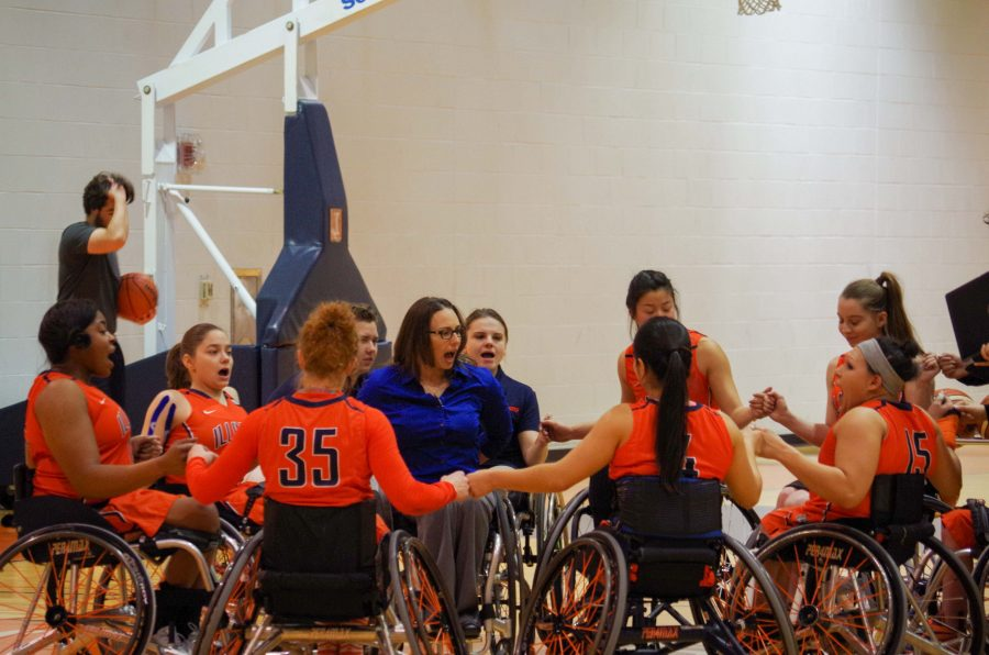 The+Illini%27s+Women%27s+Wheelchair+basketball+team+chant+during+half-time+against+the+Canadian+National+Academy+in+the+ARC+on+Friday%2C+Jan.+27th.