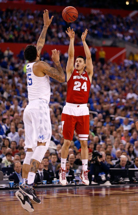 Wisconsin's Bronson Koenig (24) hits a 3-pointer over Kentucky's Willie Cauley-Stein (15) in the NCAA Tournament national semifinal at Lucas Oil Stadium in Indianapolis on Saturday, April 4, 2015. Wisconsin advanced, 71-64.