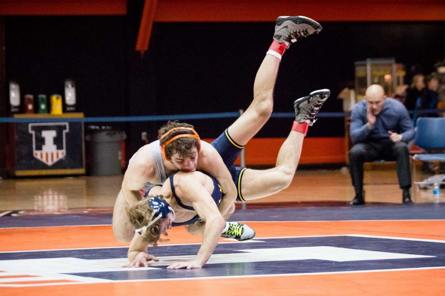 Illinois%27+Zane+Richards+wrestles+with+Michigan%27s+Stevan+Micic+in+the+133+pound+weight+class+during+the+match+at+Huff+Hall+on+Friday%2C+January+20.+Richards+won+by+decision+and+the+Illini+defeated+the+Wolverines+34-6.