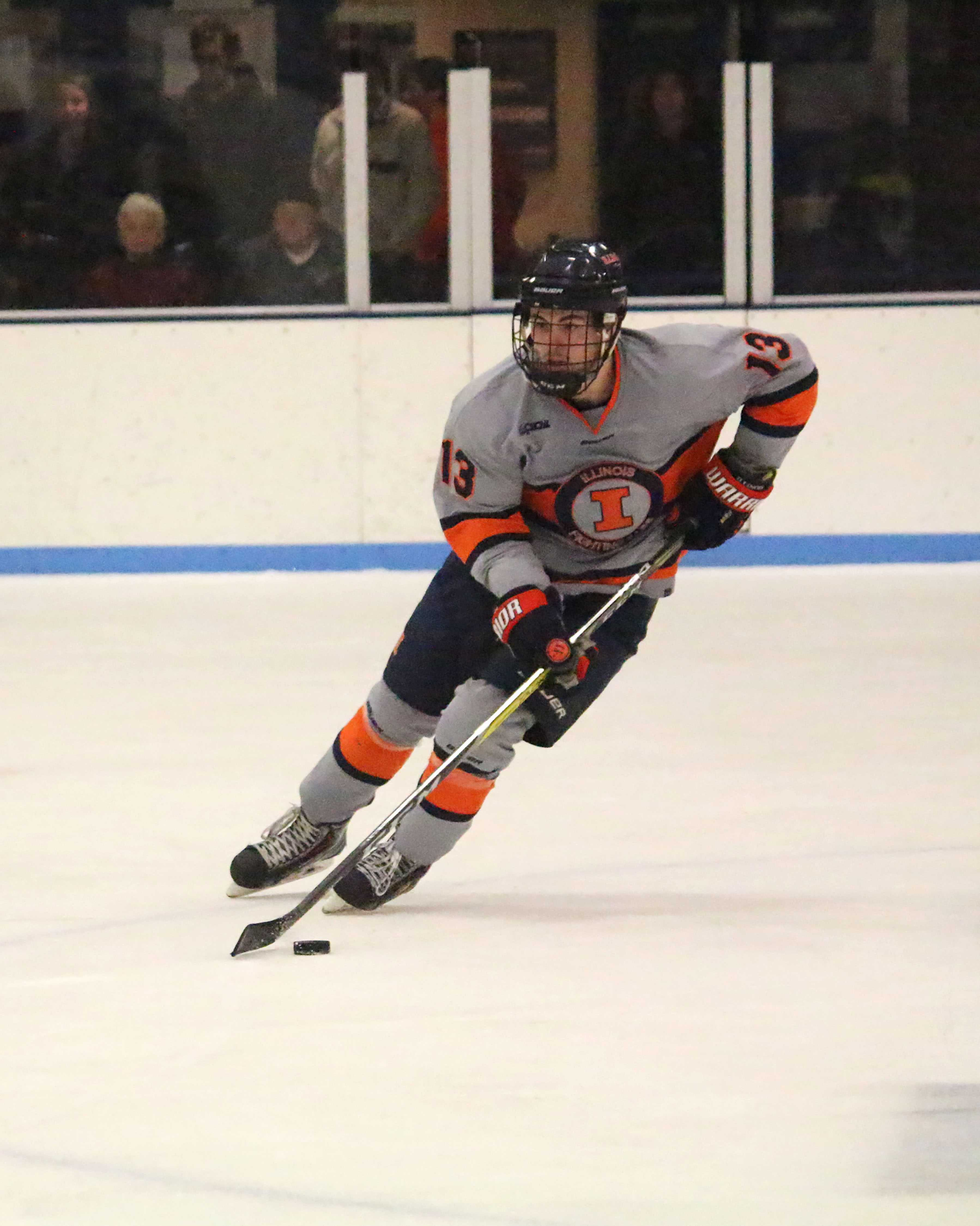James McGing (13) gains possession against Lindenwood to take the puck up the ice at the Ice Arena on Friday, Jan. 20th. Illini lost to Lindenwood 2-6.