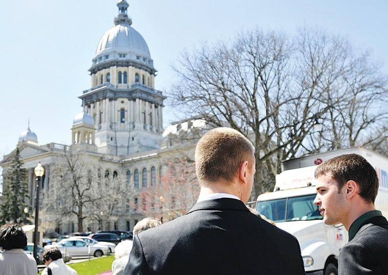 Nick Esterman, left, junior in LAS, and Jeff Schroeder, sophomore in ENG, walk towards the State Capital Building in Springfield on Wednesday, April 1, 2009.