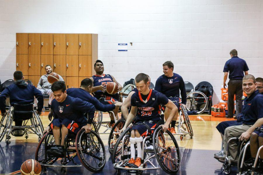 Illinois men's wheelchair basketball practices during halftime in the match against Canadian Academy on Jan. 28. The team will head to the National Intercollegiate Wheelchair Basketball tournament this weekend.