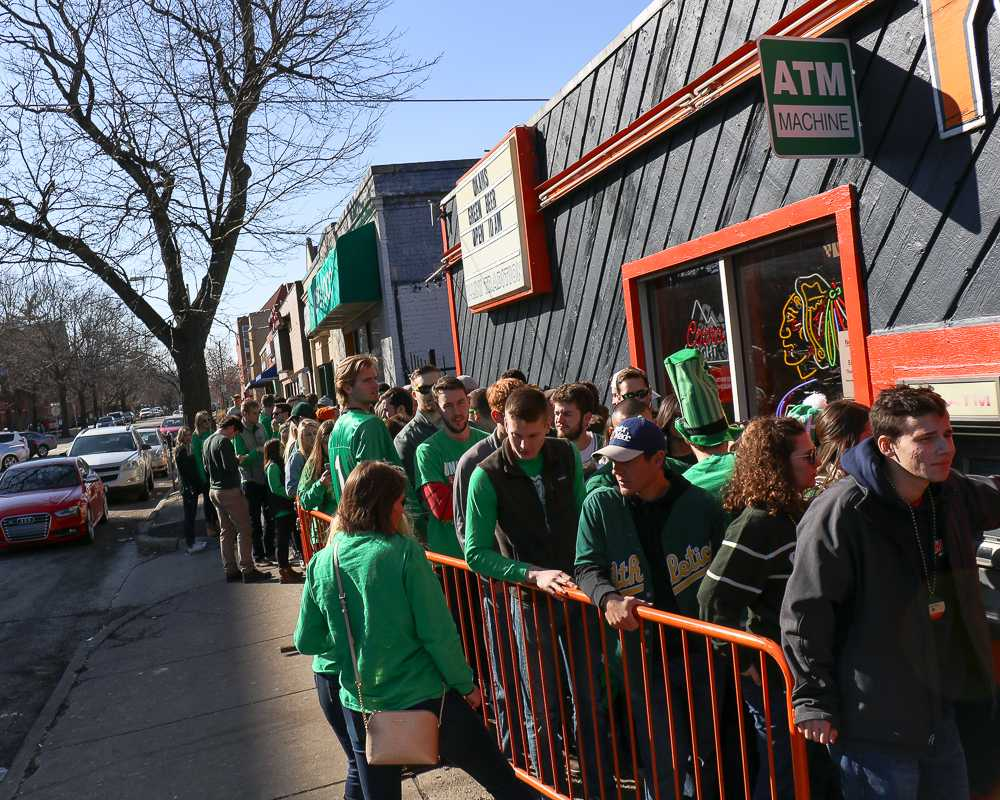 A line for Kam's stretches down Daniel St. as people wait to enter and celebrate Unofficial earlier this year. Despite the festivities, the University dropped from No. 3 to No. 14 on the Princeton Review's list of top party schools.