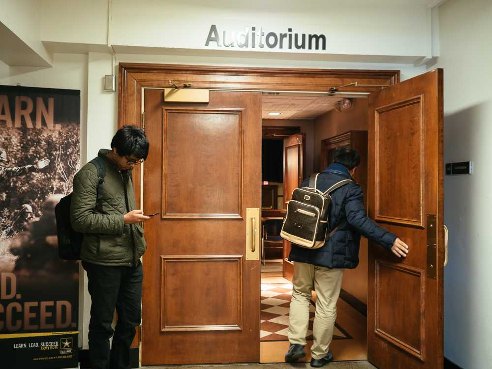 "Ryan Fang the daily illini Students enter Armory 101 for the Journalism 200 class on Monday. Some students and teachers view Trump's ""fake news"" rhetoric to be problematic to the legitimacy of the media and stifling to the freedom of the press."