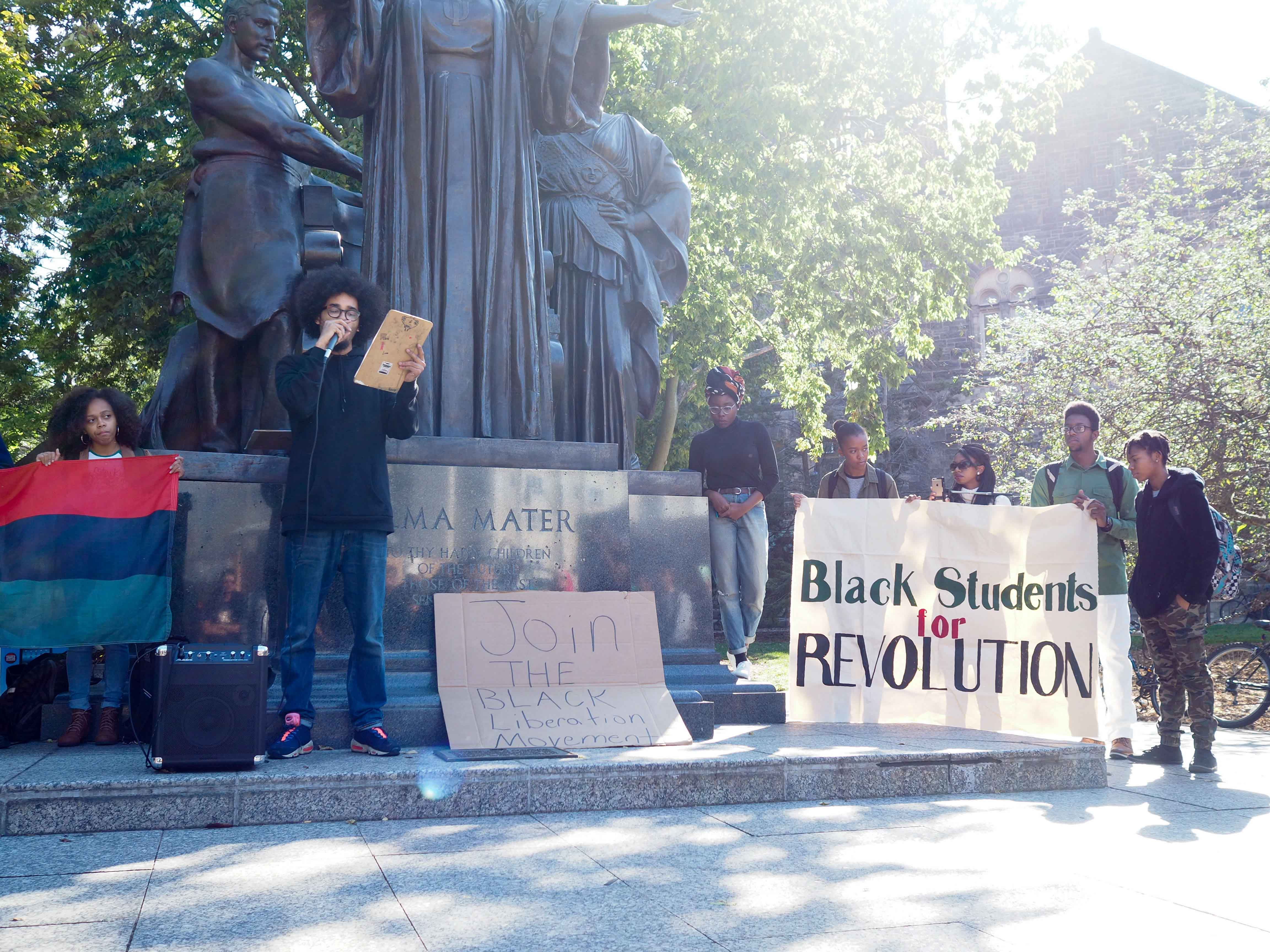 Sunny Ture, co-organizer of Black Students for Revolution, rallies students to march down Green Street on October 24, 2016.