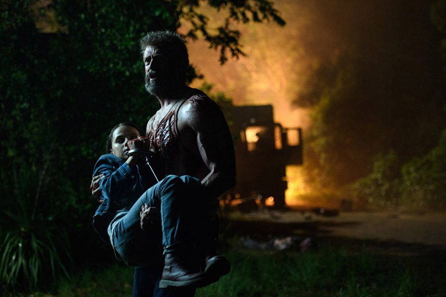 """Logan/Wolverine (Hugh Jackman) tries to protect the young mutant Laura (Dafne Keen) in """"Logan."""""""