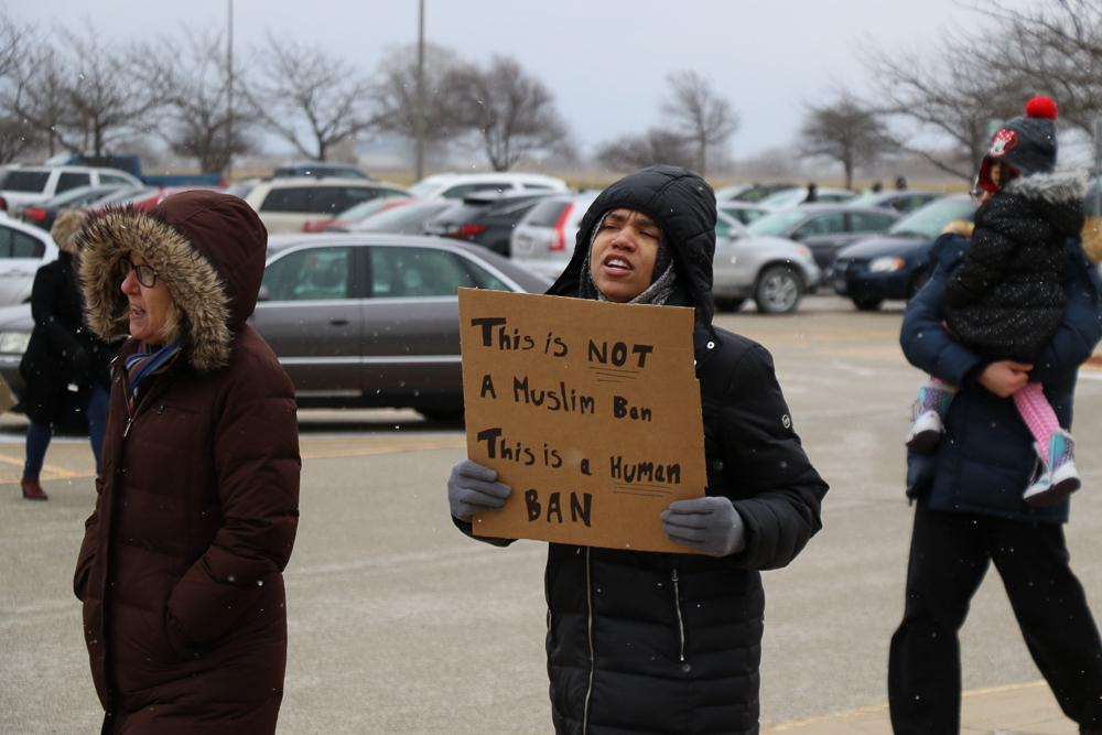 Protestors march in response to President Trump's first travel ban in front of Willard Airport on Jan. 29. Students without citizenship face detrimental consequences because of the ban.