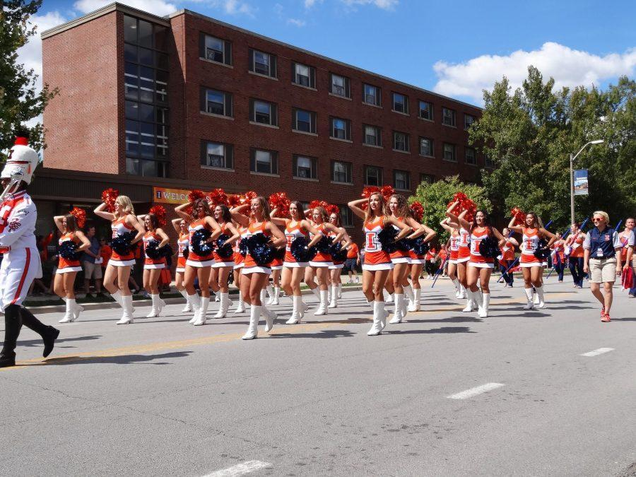 The+Illinettes+march+in+a+parade+on+campus.+The+Illinettes+practice+almost+every+day+and+most+audition+for+spots+before+performances.+