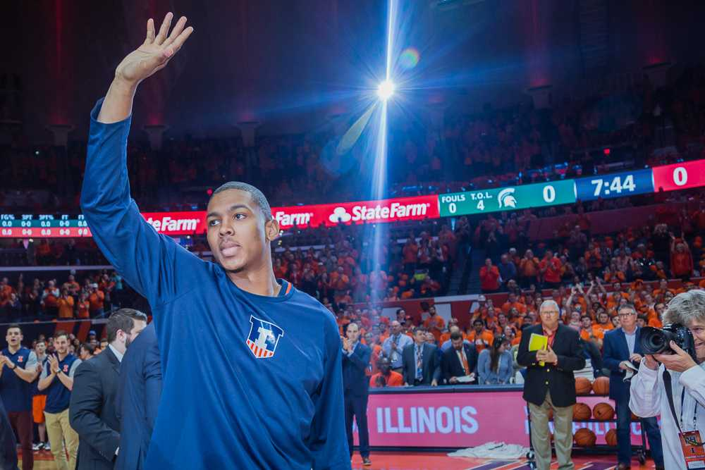 Illinois' Malcolm Hill waves to the crowd before the game against Northwestern at State Farm Center on Feb. 21. Hill is eight points away from the No. 3 spot on the all-time scoring list.