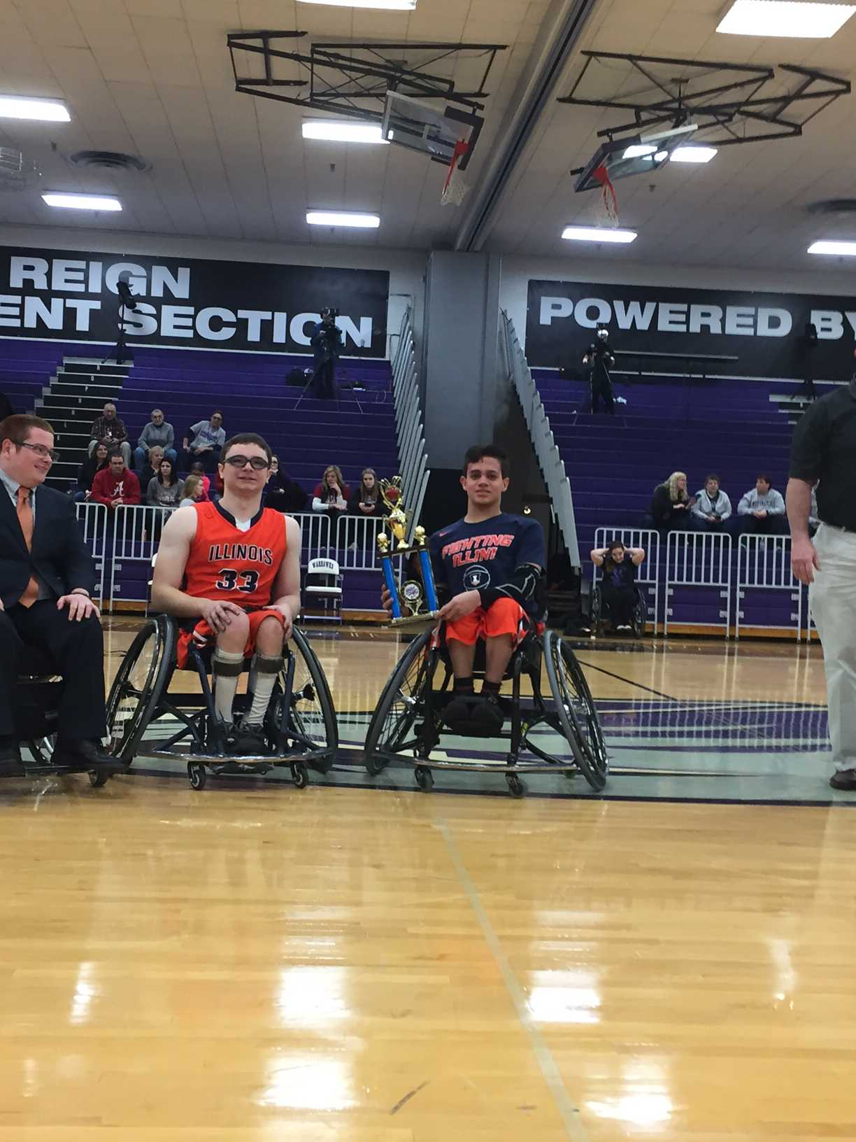 Freshman Dago Saenz and, from left to right, Colin LaFon and Tim Culbertson, holds on the fourth-place trophy after losing to Alabama in the National Intercollegiate Wheelchair Basketball Association. The loss came after defeating Edinboro in overtime and falling to rival Whitewater over the weekend.