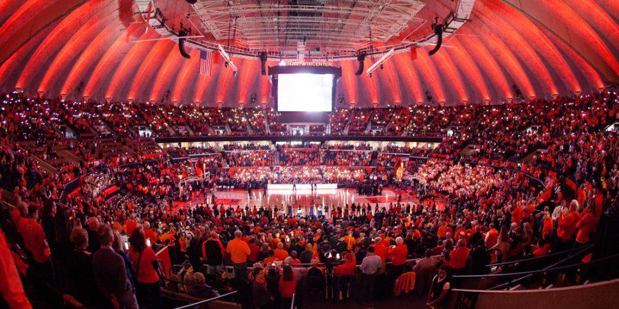Fans hold up the flash lights on their phones for a light show before the game against Minnesota at State Farm Center on Saturday, February 4. The Illini lost 68-59.