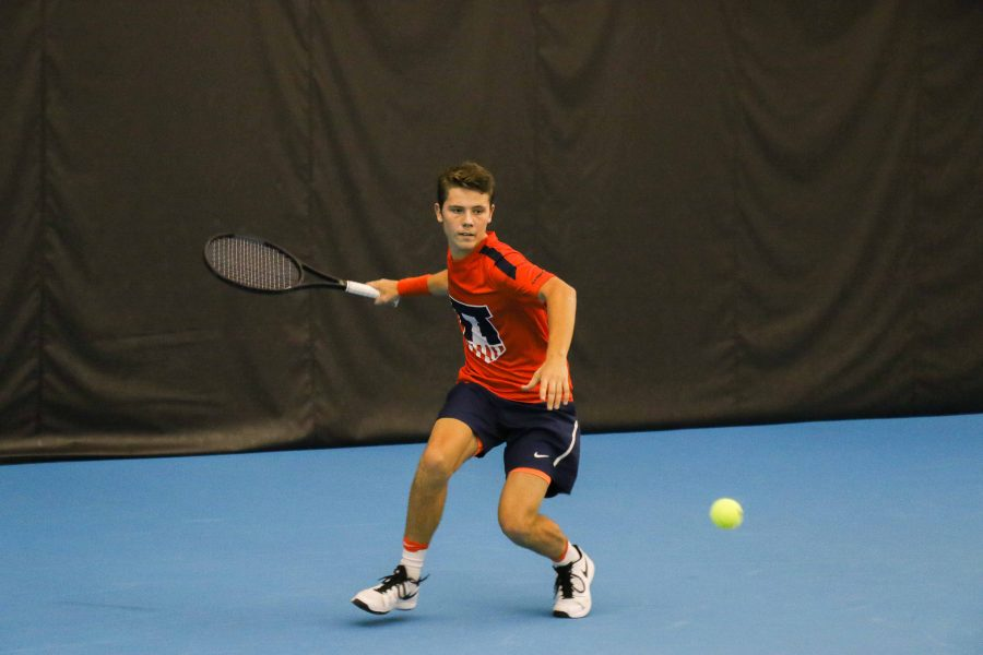Illinois%E2%80%99+Aleks+Kovacevic+prepares+to+strike+back+the+ball+in+the+match++against+University+of+Kentucky+on+Friday%2C+Feb.+24+at+the+Atkins+Tennis+Center+in+Urbana.+The+team+is+starting+to+improve+now%2C+being+2-1+in+the+Big+Ten+and+9-5+overall+this+season.+