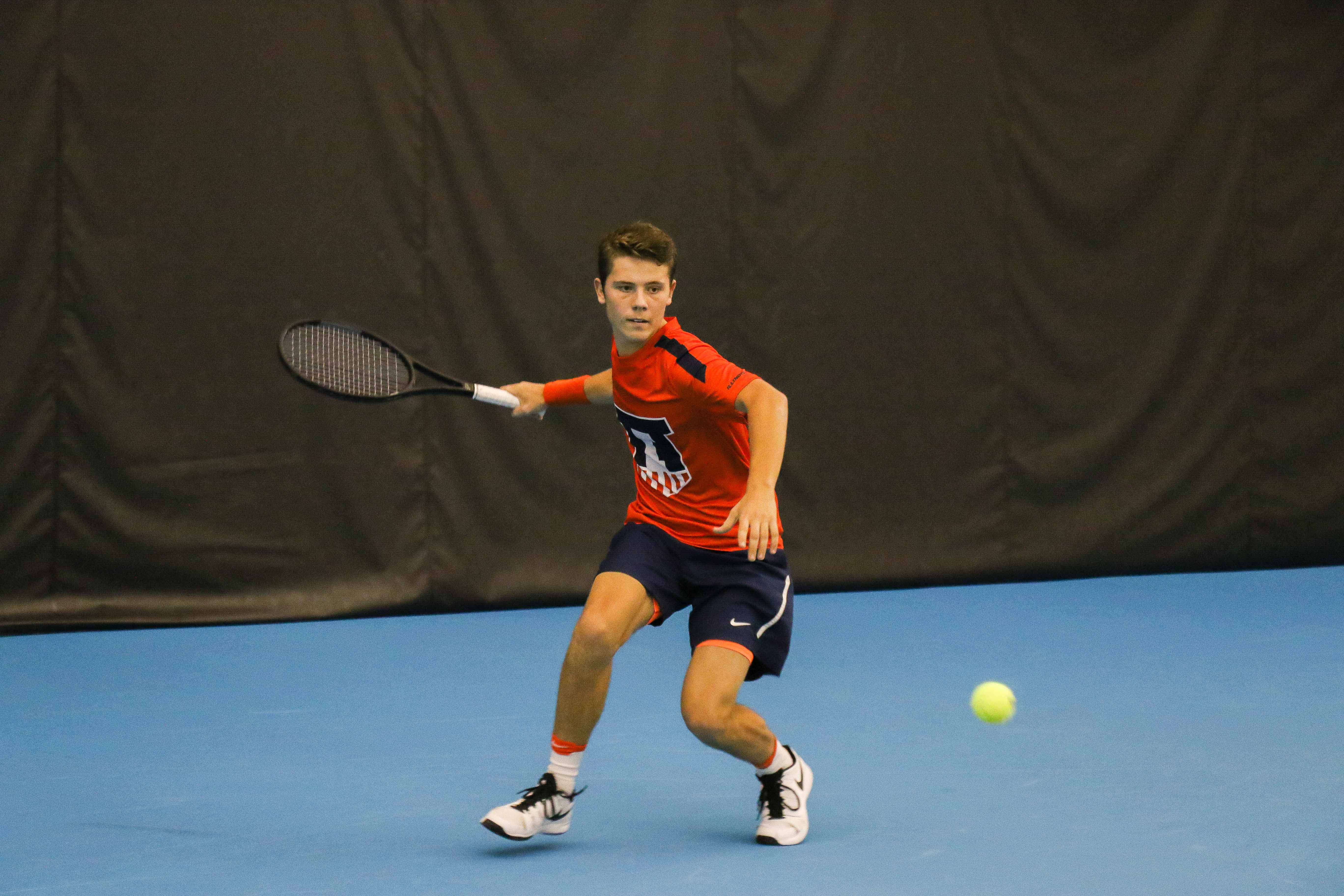 Illinois' Aleks Kovacevic prepares to strike back the ball in the match  against University of Kentucky on Friday, Feb. 24 at the Atkins Tennis Center in Urbana. The team is starting to improve now, being 2-1 in the Big Ten and 9-5 overall this season.