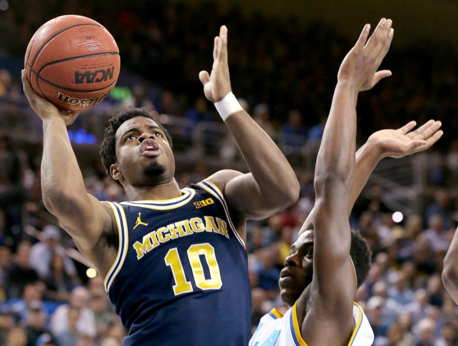 Michigan's Derrick Walton Jr. (10) drives to the basket against UCLA's Xavier Simpson in the first half on Dec. 10, 2016, at Pauley Pavilion in Los Angeles. (Luis Sinco/Los Angeles Times/TNS)