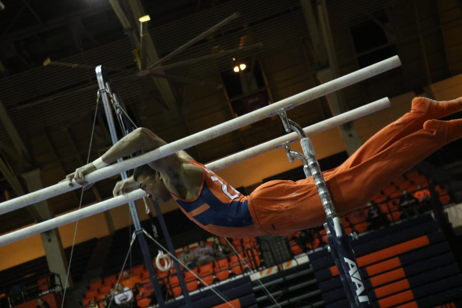 Illinois%E2%80%99+Chandler+Eggleston+swings+on+the+parallel+bars+in+the+meet+against+Minnesota+at+Huff+Hall+on+Jan.+28.+After+their+Puerto+Rico+tournament%2C+the+Illini+will+head+to+Ann+Arbor%2C+Michigan+the+following+weekend.+
