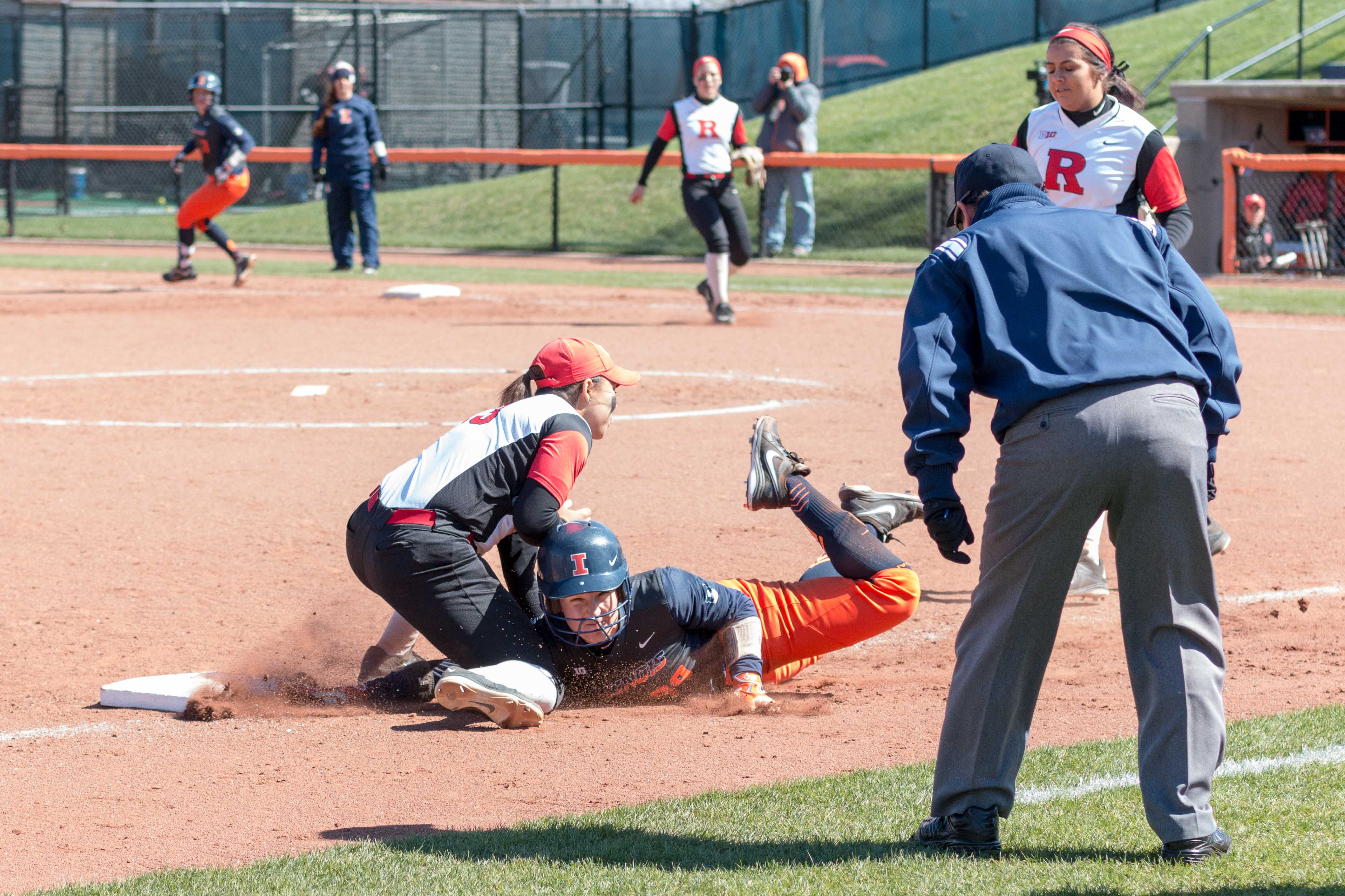 Illinois' Annie Fleming dives back to third during a game against Nebraska at Eichelberger Field on April 2. Fleming had a strong performance the last time the Illini played at ISU.