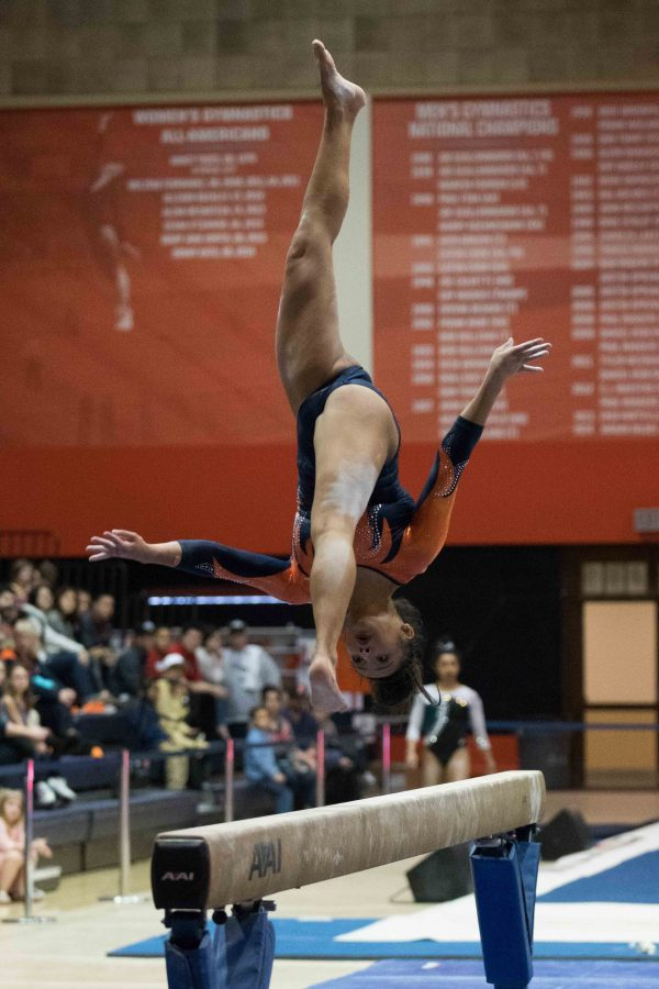 Lizzy LeDuc competes on beam against Michigan State in Huff Hall on Feb. 17. LeDuc and her childhood friend, UCLA gymnast Katelyn Ohashi, have remained close throughout their college careers.