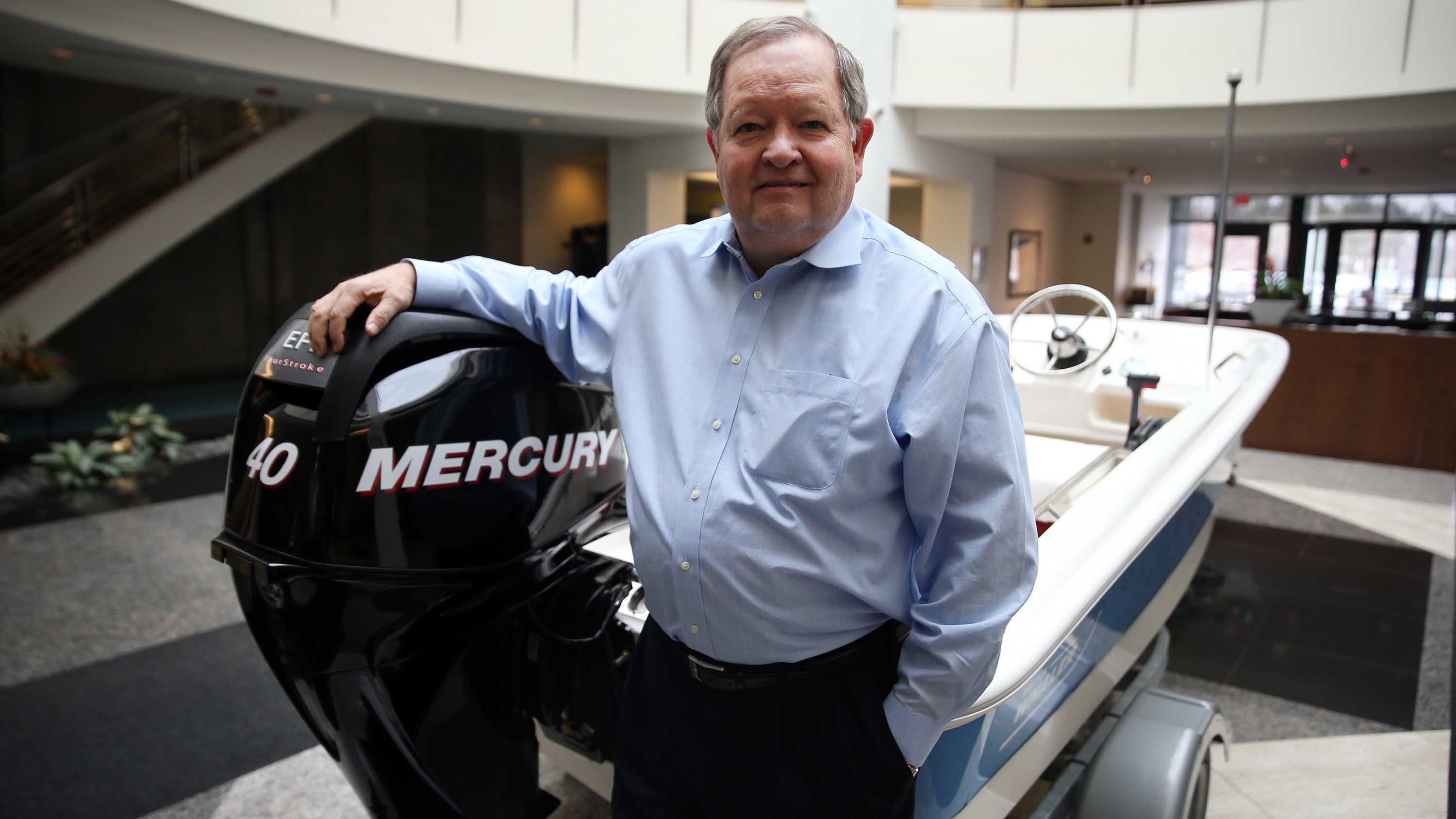 Brunswick Corporation Chairman and Chief Executive Officer Mark D. Schwabero is seen with one of the company's boats and engines at the company's headquarters on Thursday, Feb. 19, 2016 in Lake Forest, Ill.