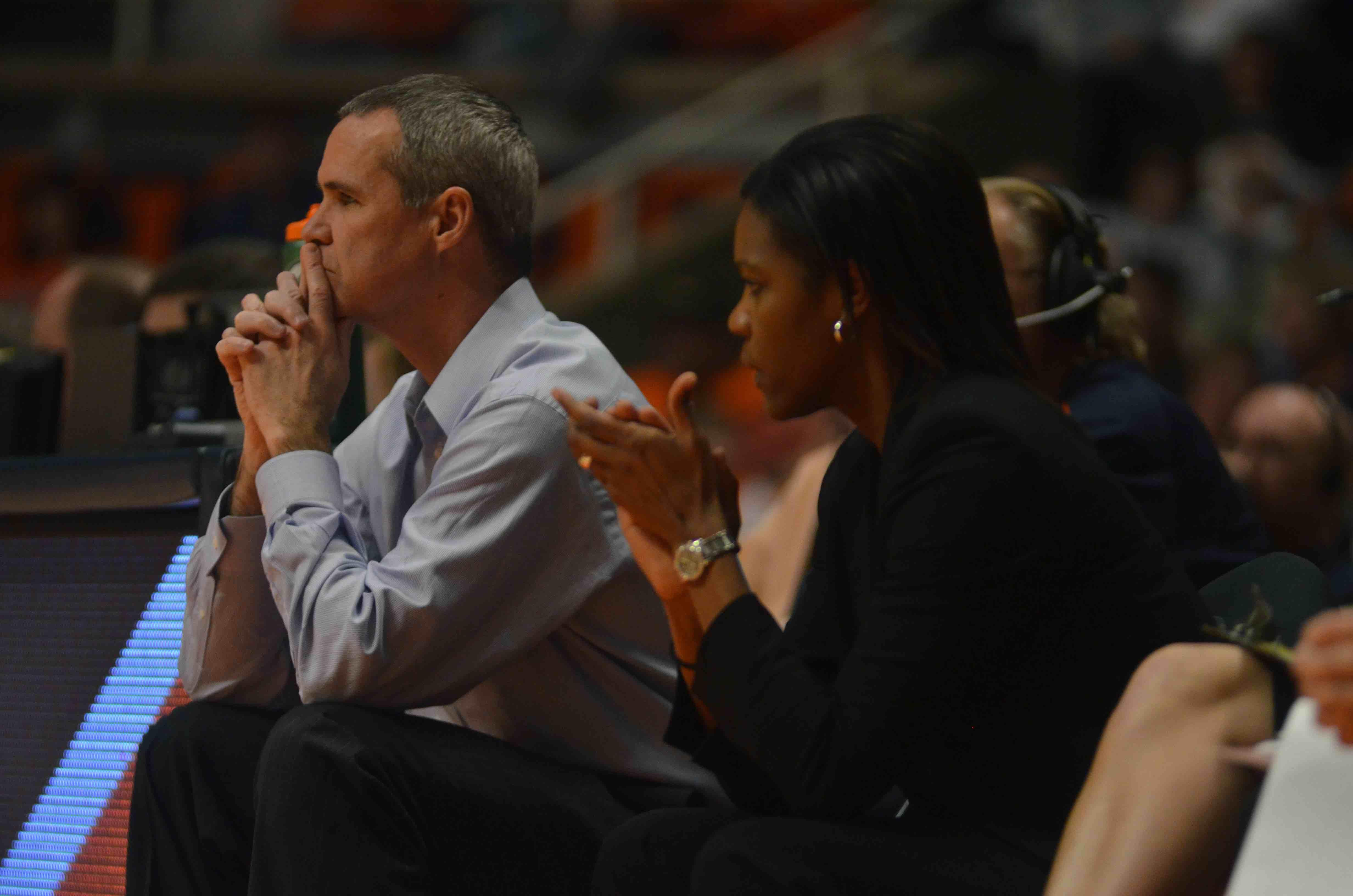 LaKale Malone coaches on the sideline during an Illinois women's basketball game in February.